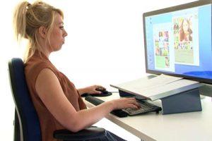 Female using DSE computer workstation