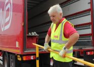 Man lifting a lorry tail-lift barrier