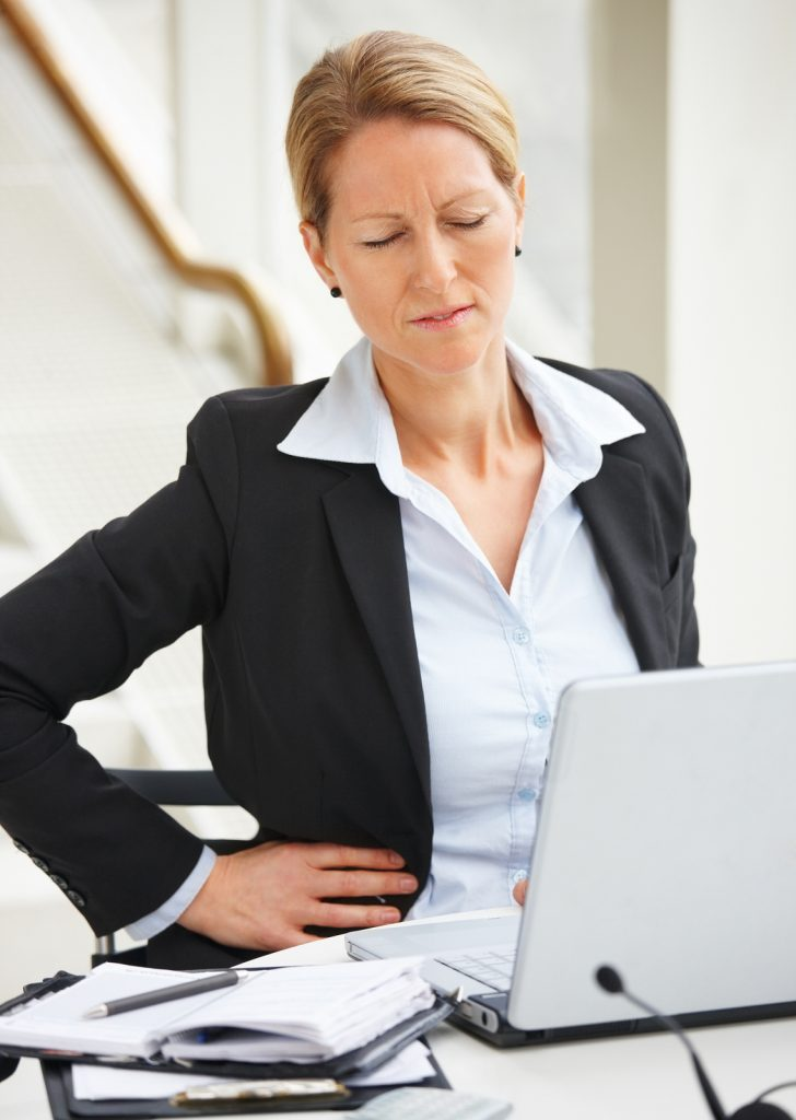 Woman appearing to be suffering from lower back pain