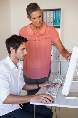 DSE Assessor assisting office worker