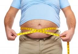 bigstock-Fat-man-holding-a-measuring-ta-44302435