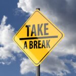 "Sign post with caption ""take a break"""