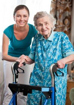 People Moving and Handling delegate assisting elderly patient