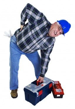 Workman with backache lifting