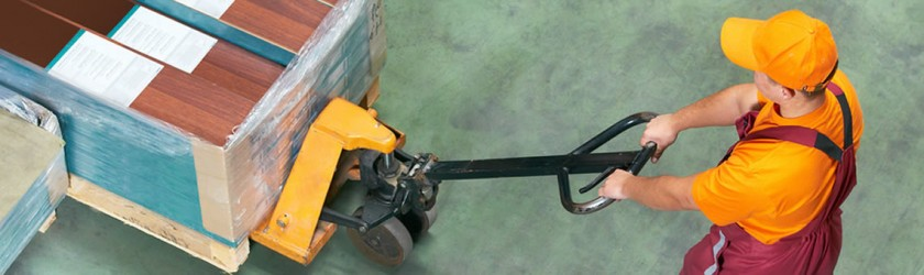 Man performing push/pull manual handling task with a pallet truck.