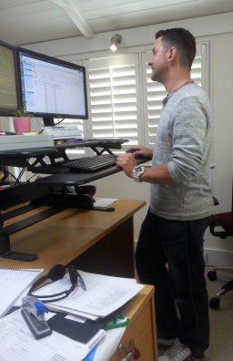 Steve standing at his desk